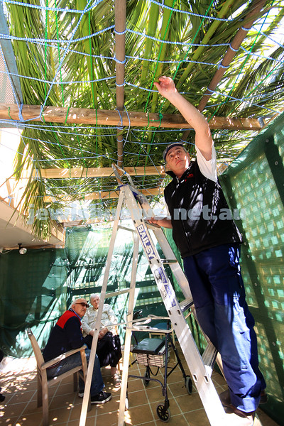 29/9/09. Alex Stinerman prepares the Sukkah at the Emmy Monash Home for the Aged. photo: peter haskin
