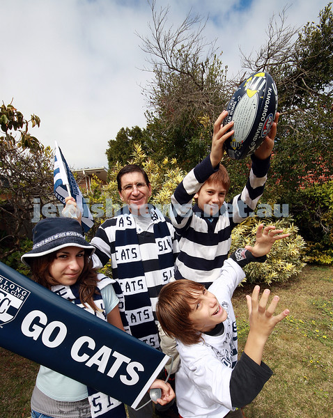 David Cherny with his children,  Yael, Tomer and Gil ,  before the 2007 Geelong AFL Grand Final. photo: peter haskin.