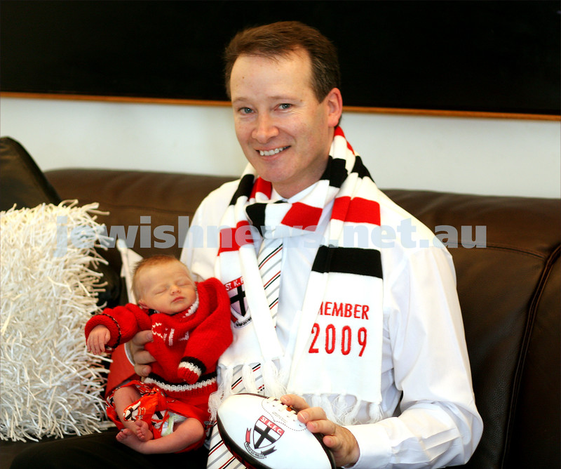 22/9/09. St Kilda football club vice president Ross Levine gearing up during grand final week. Holding one week old daughter Ava. photo: peter haskin