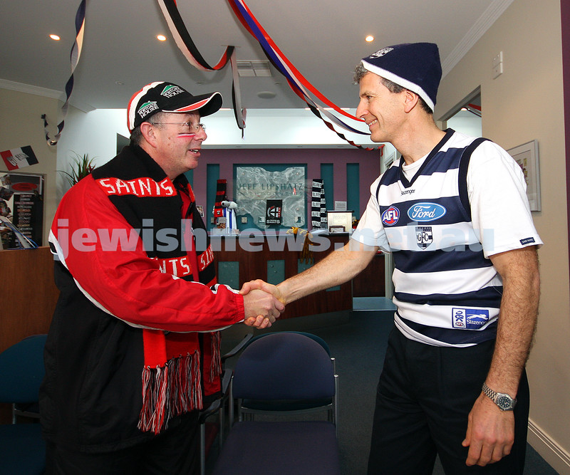 22/9/09. Grand Final 2009. Avid St Kilda supporter Gary Brand (left) with Geelong devotee Jeff Lipshatz. photo: peter haskin