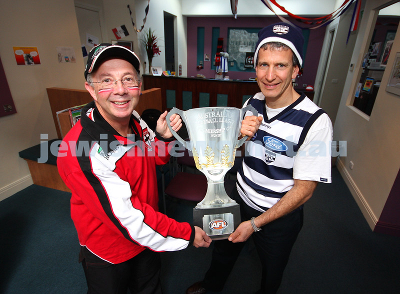 22/9/09. Grand Final 2009. Avid St Kilda supporter Gary Brand (left) with Geelong devotee Jeff Lipshatz. Premiership cup. photo: peter haskin