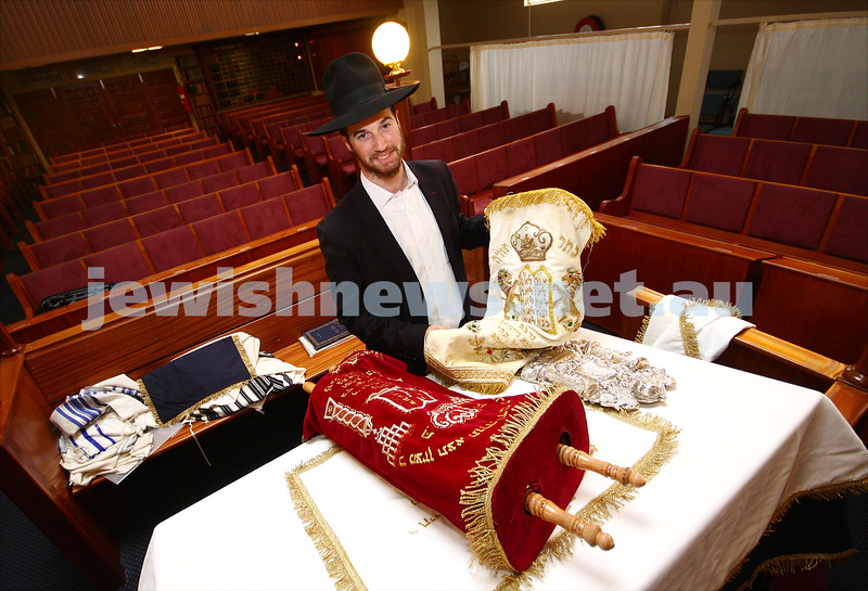 9/9/09. South Caulfield Hebrew Congregation. Dov Barber preparing for Rosh Hashana. Changing the cover on the bimah and the torah covers to the traditional white. photo: peter haskin