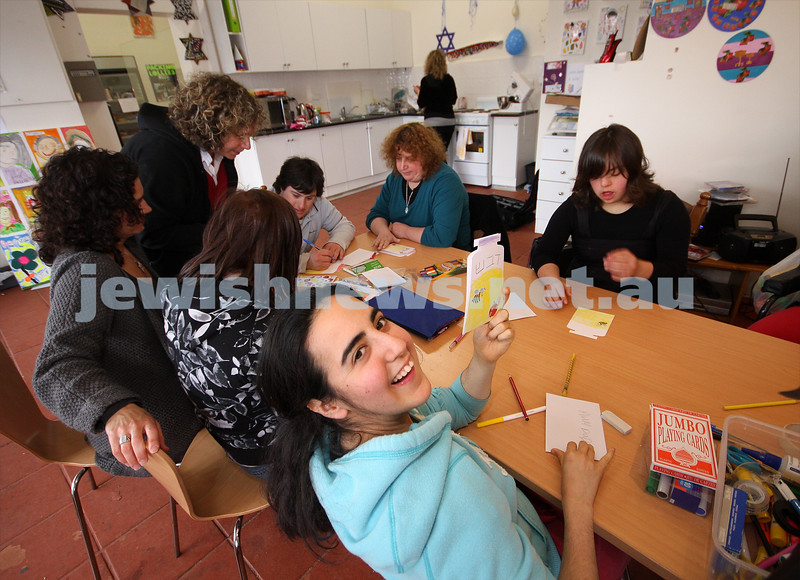 17/9/09. Access Group. Memebers of Access working at the Access shop on Inkerman Rd making Rosh hashanah cards. Lauren Goldbloom holding up her card. photo: peter haskin