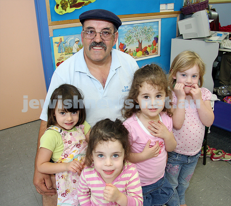 Mizrachi caretaker of 30 years Sam Paino with Junior Kindergaten children. From left: Yasmin baranov, ashira junger, dahlia brykman, jamie blecher. photo: peter haskin
