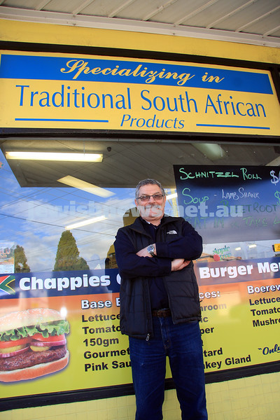 "Sid Barrnett. Came to Australia 30 years ago from South Africa. Standing outside his shop ""Chappies"". photo: peter haskin"
