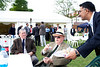 Guests at at the Royal Wedding Party held by the Ahmadiyya Musllim Community UK enjoying the sunny weather and food and refreshments