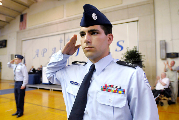 Vito Amalfitano salutes his school as APA's class of 2013 removed their graduation caps and gowns to reveal their Air Force JROTC uniforms for the salute.