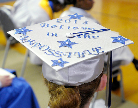 Autumn Burden decorated her mortarboard as 49 students graduated at APA on Thursday.