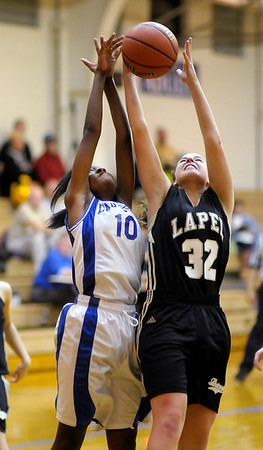 Lapel's Stephanie Pritchett and APA's Shania McNutt go up for a rebound as the Jets hosted the Bulldogs on Friday.