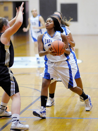 APA's Janae Davis drives to the basket as the Jets hosted the Lapel Bulldogs on Friday.