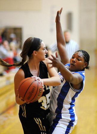 APA's Justice Stephens guards Lapel's Jessica Huffman as the Jests hosted the Bulldogs on Friday.