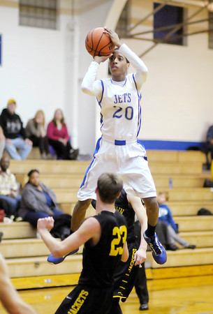 Don Knight / The Herald Bulletin<br /> APA's Leo Harris shoots as the Jets hosted Morristown on Thursday.
