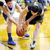 Don Knight / The Herald Bulletin<br /> APA's Zach MacGilvray and Morristown's Mark Shamblin scramble for a loose ball on Thursday.
