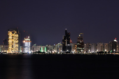 UAE - Abu Dhabi Corniche (At Night) Abu Dhabi is the capital of the United Arab Emirates (UAE), which is ruled by HH Khalifa bin Zayed Al Nahyan – the President of the UAE. Abu Dhabi lies on a T-shaped island jutting into the Persian Gulf from the central western coast. One of the world's largest producers of oil, Abu Dhabi has actively attempted to diversify its economy in recent years through investments in financial services and tourism.