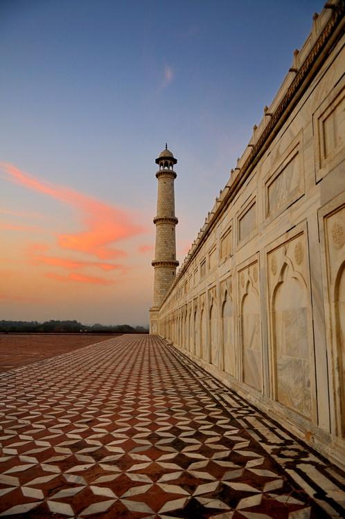 Minaret of the Taj Mahal at sunset