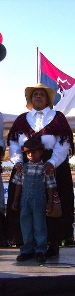Ladies of the Regiment and children on stage at Juneteenth Celebration, South Mountain Community College, Phoenix, AZ.