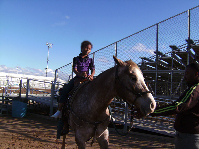 "RAWHIDE ""Bill Pickett Rodeo"" Wild Horse Passes, Chandler.  Young Lady of the Regiment taken a break before the second show Grand Entry."