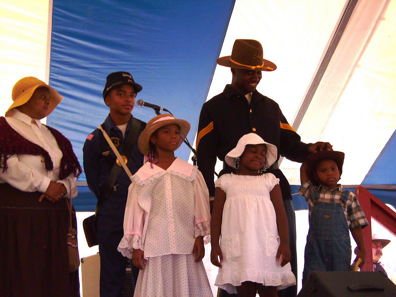 "Our children enjoyed being with Lt. Edward Reece (father) while on stage at Ghostfield Ghost Town Festival ""National Day Cowboy"", Apache Junction, AZ. Buffalo Soldiers and Lady and Gentlemen of the Regiment presentation."