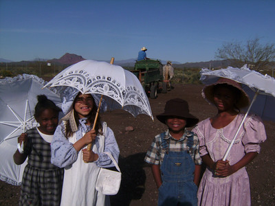 Our future Young Buffalo Soldier and Young Ladies of the Regiment enjoying riding on a haywagon.