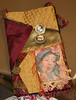 beautiful hand made purse, very creative! look at the locket sewn on with old photos in it!! AWESOME!!