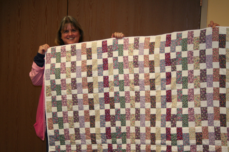 Me and the first quilt I ever made in my life!