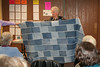 this is very clever! its a picnic throw for you car made out of old jeans! the pockets in the corners have velcro so you can store your keys and such while relaxing! I may have to make one of these!!! (this photo is blurry, but there are others that are better, keep looking)