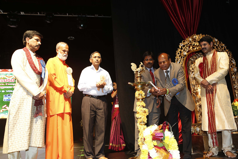ATA executive Hanumanth Reddy lightning the lamp to inaugrate 12 ATA Convention in Atlanta on 7th July 2012...pic Mohammed Jaffer-SnapsIndia