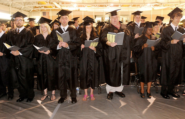 """Graduates sing the hymn """"Joyful, Joyful, We Adore Thee"""" during Anderson University's 94th Commencement on Saturday."""
