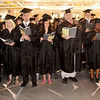 "Graduates sing the hymn ""Joyful, Joyful, We Adore Thee"" during Anderson University's 94th Commencement on Saturday."