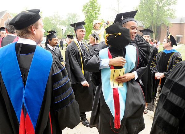 Graduates greet faculty members as they enter the Kardatzke Wellness Center for Anderson University's 94th Commencement on Saturday.