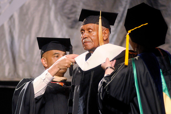 Johnny Wilson receives and honarary degree during Anderson University's 94th Commencement on Saturday.