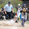 Don Knight | The Herald Bulletin<br /> Anderson University's Shelby Shaffer slides safely into home on a bunt by Taylar Kelso as Anderson beat Bluffton to win the HCAC tournament on Saturday.