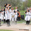 Don Knight | The Herald Bulletin<br /> The Ravens celebrate Katie McCool's homerun.