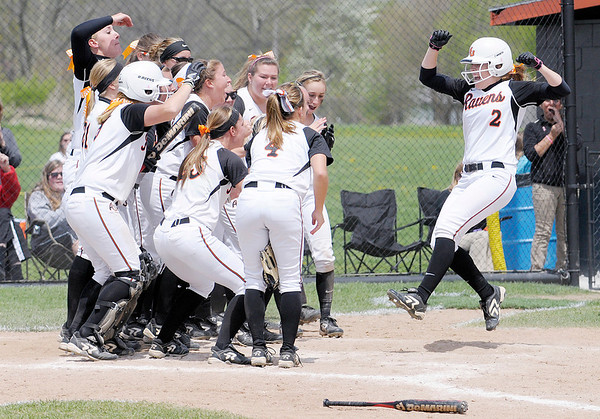 Don Knight   The Herald Bulletin<br /> The Ravens celebrate Katie McCool's homerun as the Ravens beat Bluffton to win the HCAC tournament on Saturday.