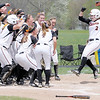 Don Knight | The Herald Bulletin<br /> The Ravens celebrate Katie McCool's homerun as the Ravens beat Bluffton to win the HCAC tournament on Saturday.