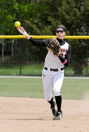 Don Knight | The Herald Bulletin<br /> Nichole Frazier throws to first.