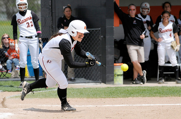 Don Knight | The Herald Bulletin<br /> Taylar Kelso lays down a bunt to score Shelby Shaffer giving AU an early 1-0 lead.