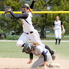 Don Knight | The Herald Bulletin<br /> Bluffton Chelsea Weitz breaks up Sorcha Cox's attempt at a double play.