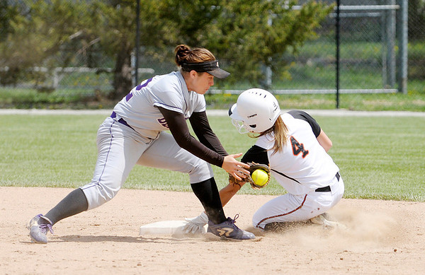 Don Knight   The Herald Bulletin<br /> Morgan Burke beats the tag as she steals second.