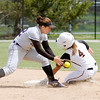 Don Knight | The Herald Bulletin<br /> Morgan Burke beats the tag as she steals second.