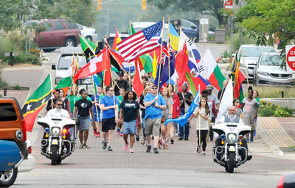 John P. Cleary | The Herald Bulletin<br /> Anderson University staff and students held a Peace and Unity March and Rally Saturday morning from the Peace Pole on campus to downtown Anderson for a peaceful display of unity.