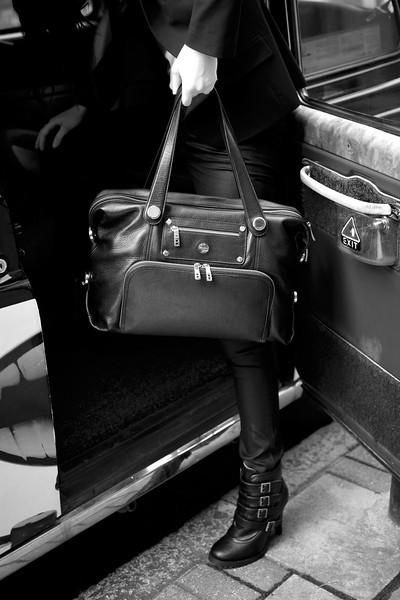 Lola_Battersea_black_model_gettingintaxi_blackandwhite_highres