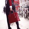 Rubi_red_woodgrain_modelholding_bikesandbuses_highres