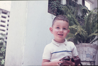 Me, circa 1963. Notice the real leather camera case. Who knew back then, I would still be holding a camera today.
