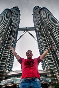 Just out front of the Petronas Towers in Kuala Lumpur, Malaysia. I look to create images and  capture moments that will inspire those who view them to get out and see the world. My portraiture is still being refined, but I enjoy a contemporary style that infuses fashion, beauty, life style and glamour styles of photography.