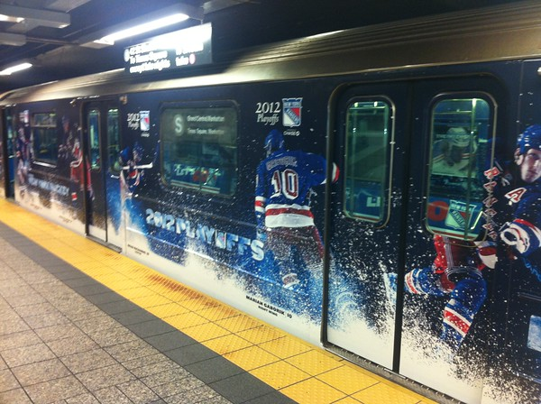 The New York Rangers kicked off their 2012 NHL playoff run by unveiling a special Blueshirt-themed custom branded CBS Outdoor Grand Central to Times Square shuttle train on Tuesday April 3.<br /> <br /> The three shuttle cars that run on Track 1 will be wrapped inside and out with Rangers branding to celebrate the team's 54th postseason appearance.<br /> <br /> Rangers fans were invited to come down to the unveiling celebration. The unveiling featured appearances by Rangers alumni, a live band, and the opportunity for fans to win a variety of Rangers prizes, including playoff tickets.