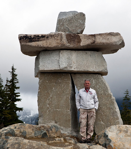Yours truly posing in front of the Inukshuk erected at the site of the 2010 Olympic Ski Jumping venues in Whistler BC.<br /> <br />  An inuksuk (plural inuksuit) (from the Inuktitut: ᐃᓄᒃᓱᒃ, plural ᐃᓄᒃᓱᐃᑦ; alternatively inukshuk in English or inukhuk in Inuinnaqtun  is a man-made stone landmark or cairn, used by the Inuit, Inupiat, Kalaallit, Yupik, and other peoples of the Arctic region of North America. This region, above the Arctic Circle, is dominated by the tundra biome, containing areas with few natural landmarks.<br /> <br /> My thanks to my good friend Larry Burton who took this image of me through my Canon 1D Mk III with a 28-105 L series lens.