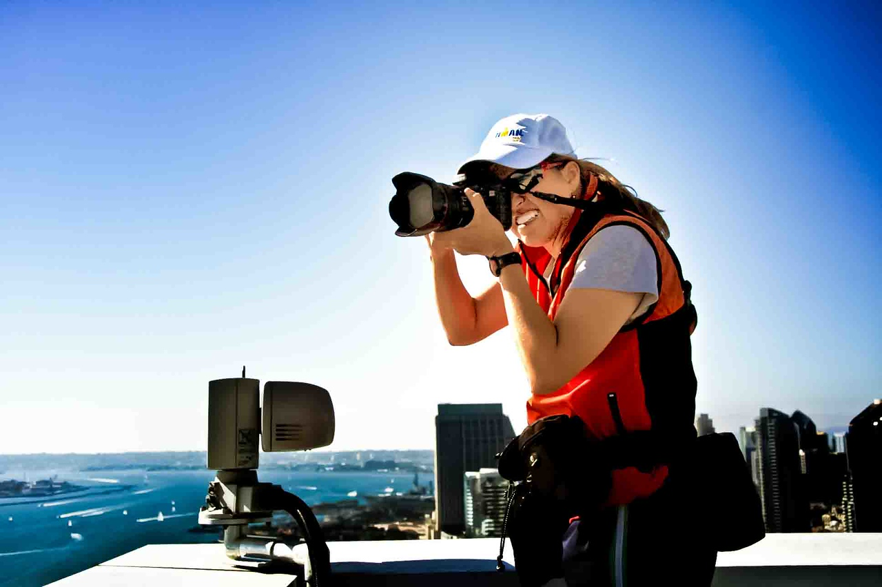 Hi! <br>This is me, shooting the Danskin Women's Triathlon in San Diego, CA., on the roof top of the Hilton Hotel, 30 stories high!</br>