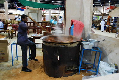A huge pot of date syrup being cooked.