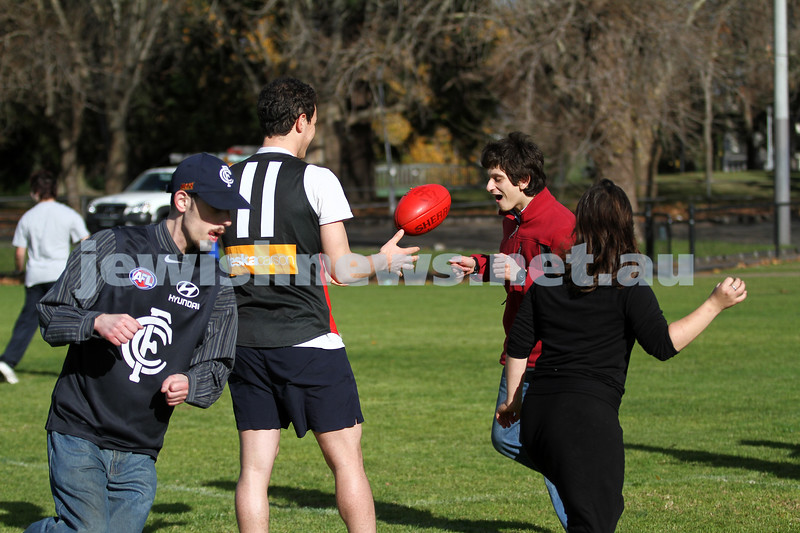 On Friday morning 15/6/2012 AJAX Football Club, represented by Warren Steinberg and Luke Jankie, responded to an invitation by Josh, one of the Access Inc. adults, to conduct a footy clinic at Caulfield Park. There were 10 Access adults with disabilities who walked with Luke and Wazza to Caulfield Park for a training session of kicking, marking, handballing and generally having fun outdoors with a footy.  Photo: Peter Haskin